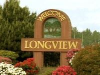 Welcome to Longview road sign with flowers